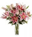 1 Florero de Vidrio, 4 Rosas - 6 Varas de Liliums/ 2 Flores por Tallo
